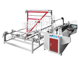 FOLDING AND WINDING MACHINE